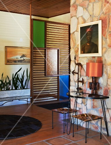 50s Style Foyer With Stone Wall Parion Stained Gl Panels And Ethnic Decor Dark Leather Patchwork Rug