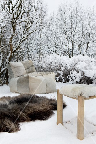 Beanbag, fur rug and stool with fur cover in snow