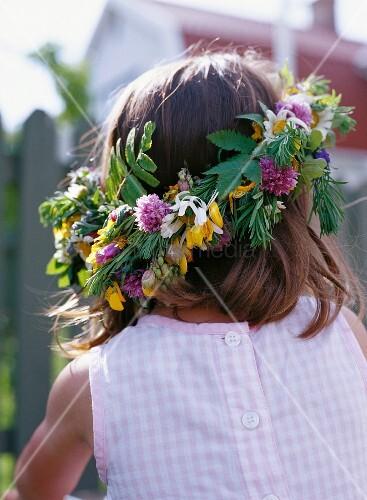 A girl wearing a midsummer wreath.