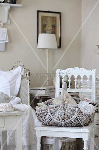 White-painted basket on old chair in living room