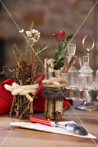 Small Vases Wrapped In Birch Branches Twigs And Tied With Felting