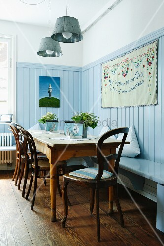 Restaurant with nostalgic atmosphere, wooden floor and pale blue wood panelling