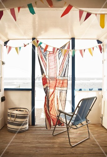 Beach hut with Union Flag curtain in doorway