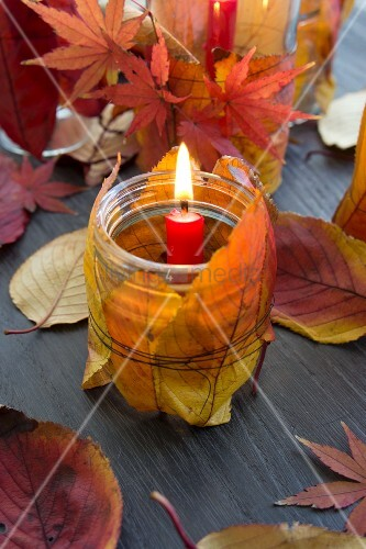 Candle lantern decorated with autumn leaves