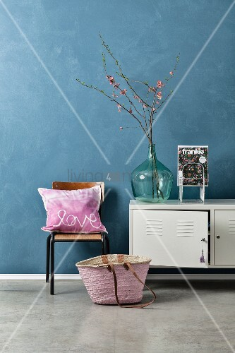 Hand-sewn pink scatter cushion next to white metal cabinet