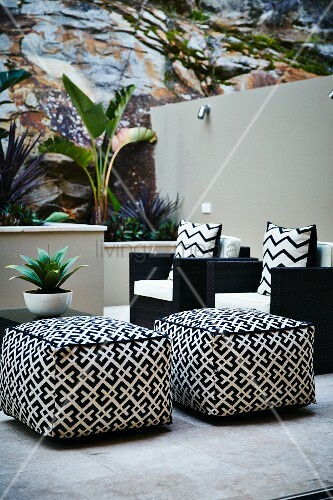 Black and white seats and side table on terrace