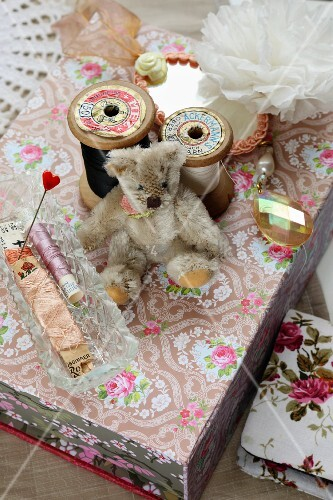 Reels of thread and small teddy bear from flea market