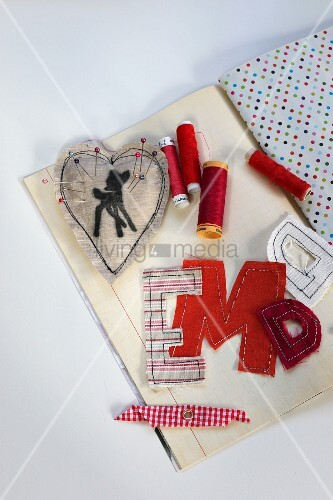 Letters cut out of fabric remnants