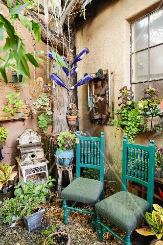 Chairs in garden; Taos; New Mexico; USA