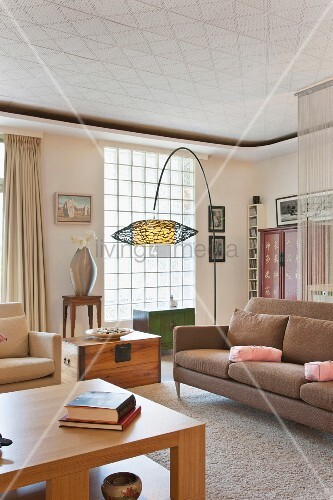 Contemporary living room with large floor lamp