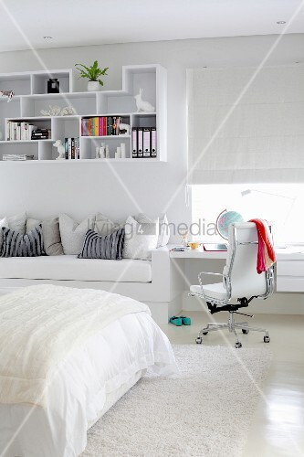 Built-in desk, couch and decorative wall shelves in white, teenager's bedroom