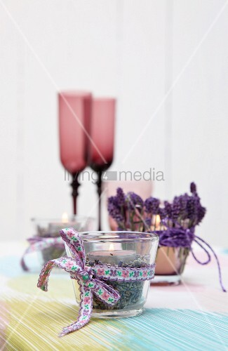 Tealight and dried lavender in tealight holder decorating table