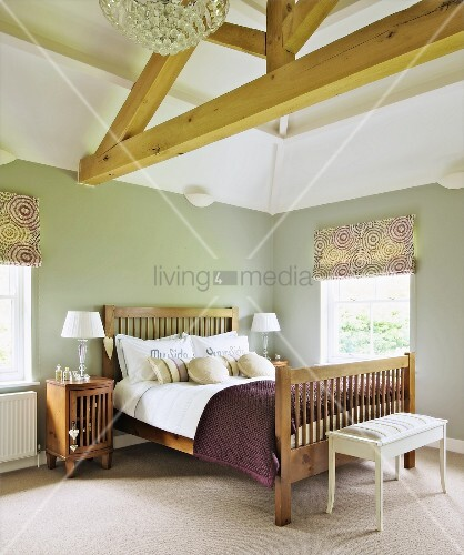 Double bed with wooden slatted headboard and foot in rustic bedroom