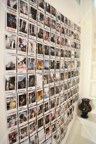 Wall collage of Polaroid souvenir photos