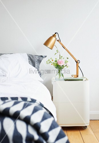Retro table lamp on bedside cabinet with castors