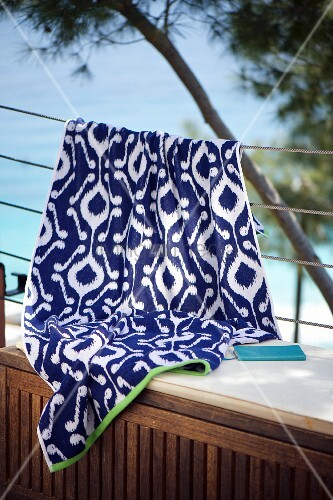 White and blue ikat cloth hung over balustrade