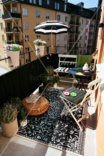 Comfortable balcony with black and white accessories