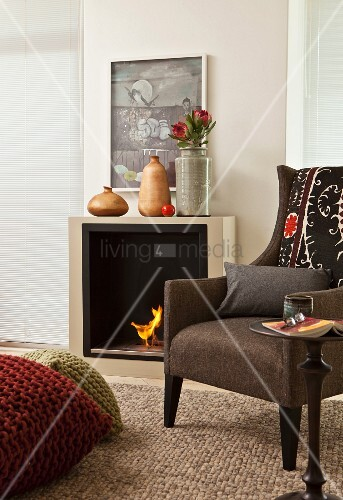 Traditional armchair in front of bio-ethanol fire in elegant interior