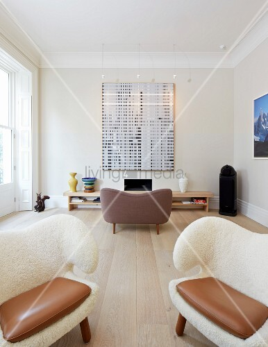 Private Apartment, London, United Kingdom. Architect: Hill Mitchell Berry, 2014. Extravagant armchairs with white, furry upholstery in living room