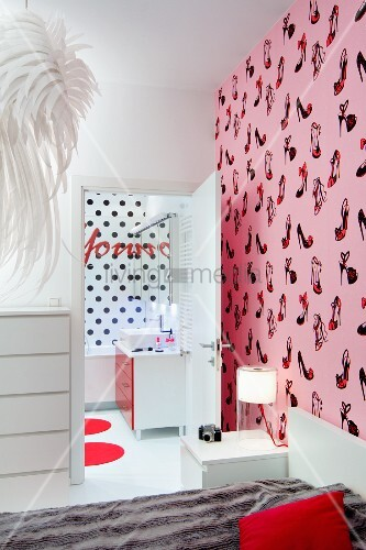 Bed Against Wall With Shoe Patterned Pink Wallpaper View Into Ensuite Bathroom Black Polka Dot