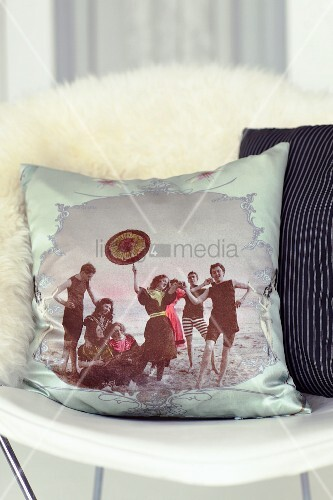 Scatter cushion with retro print on chair