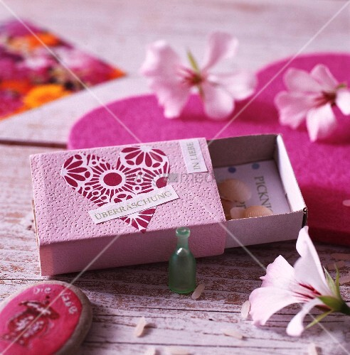 Matchbox painted and decorated with paper heart repurposed as surprise container