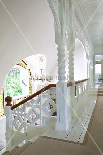 Stairwell with carved wooden pillar in manor house