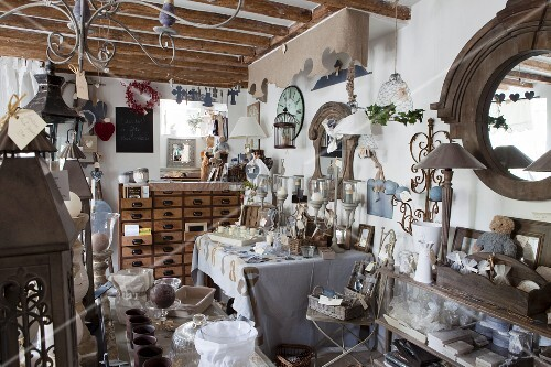 Cluttered shop selling vintage-style home accessories in restored country ouse