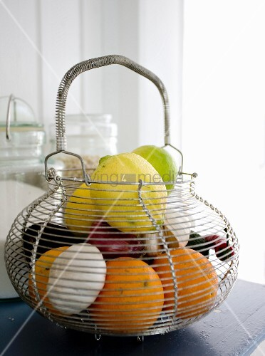 Wire basket of fresh fruit and vegetables