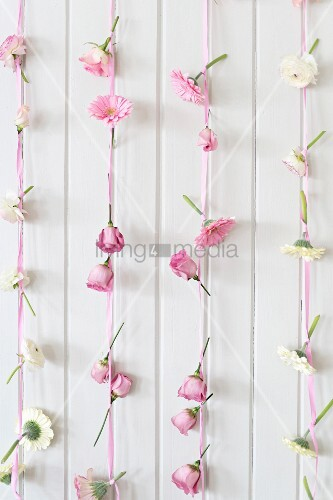 Romantic arrangement of pink and white flowers and ribbons for buffet