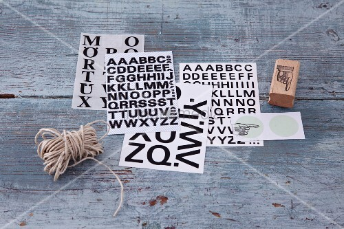 Letter stickers and a wooden stamp for decorating and labelling gifts