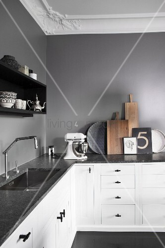 L Shaped Kitchen Counter With Dark Stone Counter And White Base