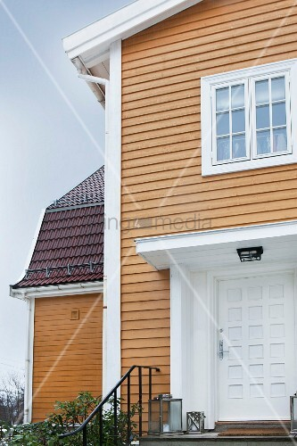 Elegant clapboard house with white porch