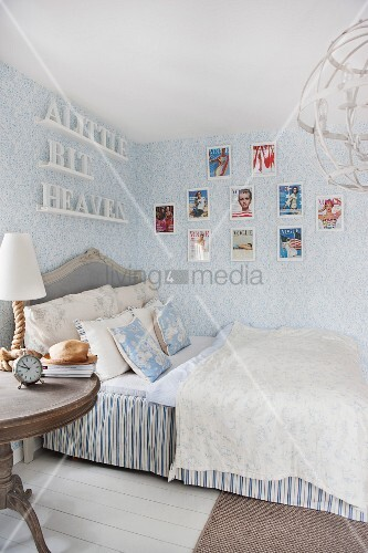 Romantic bedroom with blue and white wallpaper