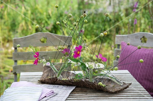 Cosmos arranged in piece of park as table centrepiece