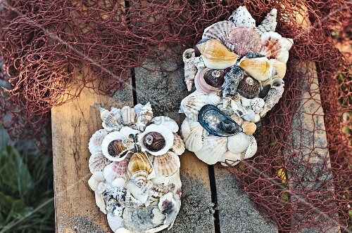 Maritime ornamental faces made from shells