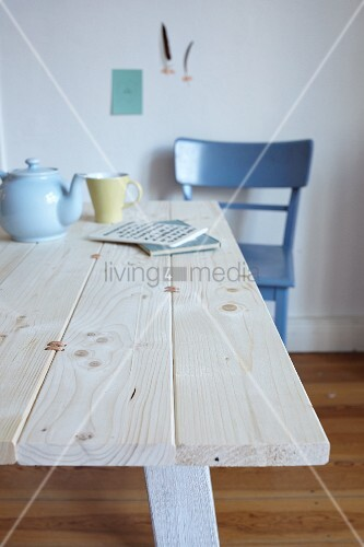 Tabletop made from pine boards joined by leather straps