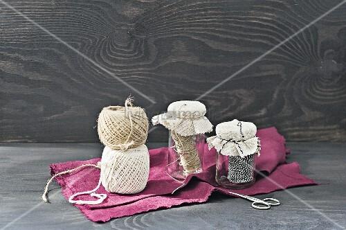 Old jam jars used as string dispensers