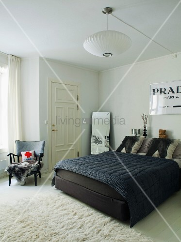 White bedroom with contrasting black bed