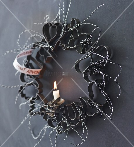 Advent wreath made from pastry cutters and a single candle