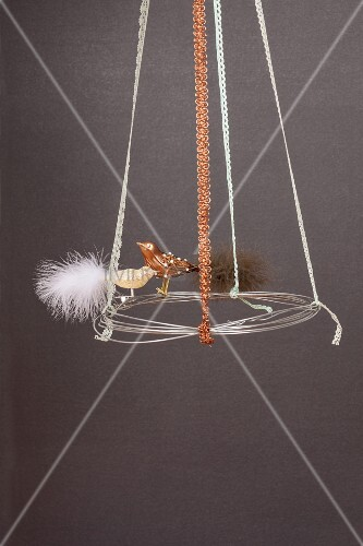 Hand-made, wintery wreath of wire, ribbons and bird figurine