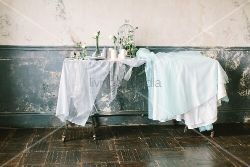 Fairy-tale dining table decorated for wedding in vintage interior