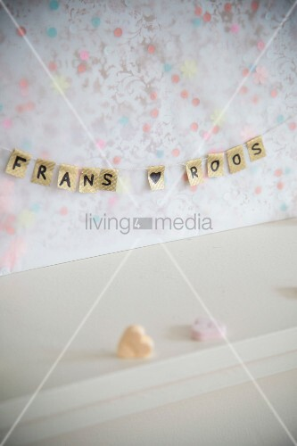 Wedding decoration: small string of bunting with names of bridal couple