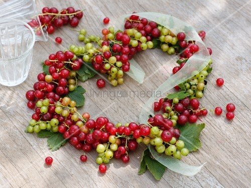 Redcurrants, whitecurrants and ribbon arranged in heart shape