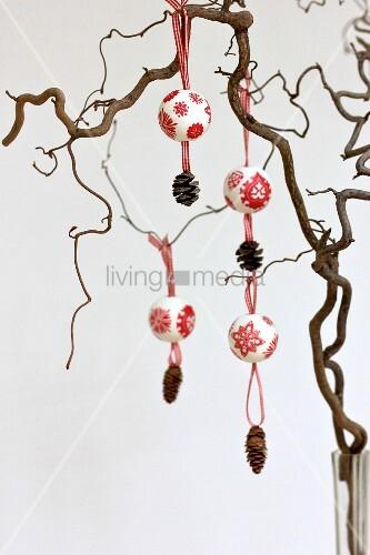 Polystyrene baubles festively decorated using napkin decoupage