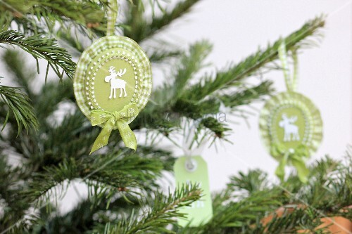 Hand-crafted, rosette Christmas tree decorations with moose motifs & ruffled ribbon