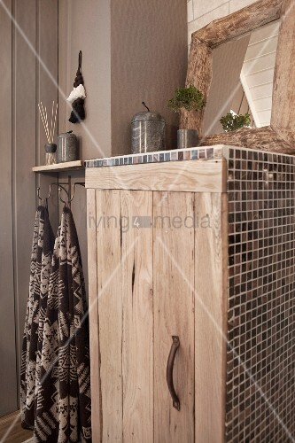 Rustic bathroom cabinet with wooden door and mosaic tiles