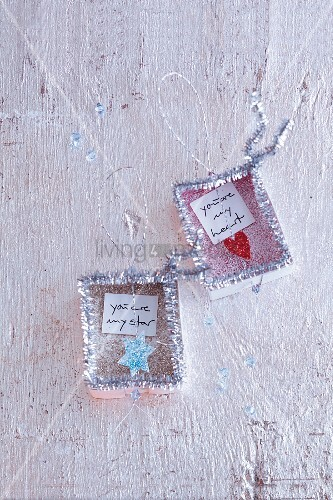Silver love notes for hanging up made with fine glitter and pipe cleaners