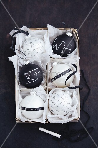 Poems on black-and-white Christmas tree baubles