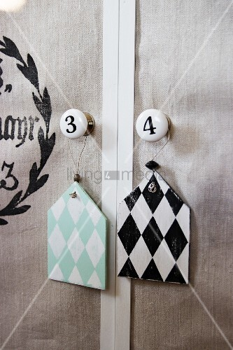 Diamond-patterned shabby-chic pendants hung on furniture knobs
